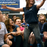 Senior Lauren Cole dances solo in the crowd to try to get the senior class pumped up for the beginning of the assembly. Photo by Annie Lomshek