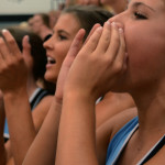 Sophomore Maggie Gray shouts as the lancer dancers perform. Photo by Annie Lomshek