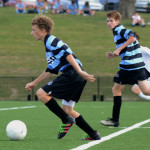 Sophomore, Davin Cox drives the ball down to the goal with sophomore, Conor O'Toole by his side. Photo by Grace Goldman