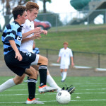 Junior, Tommy Nelson steals the ball from freshman, TJ Libeer. Photo by Grace Goldman