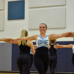 Isa Tamburini senior Varsity Lancer Dancer dances along her teammate Haley Bell as they prepare for the kick line. Photo by Katherine Odell