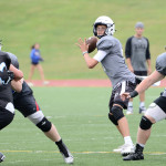 Sophomore Anderson Maddox looks to a teammate as he sets up a pass. Photo by Haley Bell
