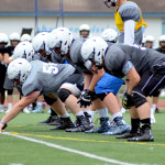 The offensive line sets up for the first play of the game. Photo by Izzy Zanone