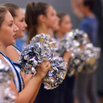 Freshman Olivia Smith cheers along with her JV Lancer Dancer team. Photo by Izzy Zanone