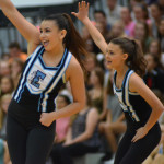 Sophomore Maggie Mulligan and Freshman Colette Worthington dance with their JV Lancer Dancer team. Photo by Izzy Zanone
