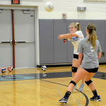 Sophomore Amanda Anderson prepares to bump the ball. Photo by Ellen Swanson