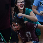 Freshman Katie Peterson and freshman Lauren Peterson splash each other with soapy sponges while waiting to clean cars. Photo by Ellen Swanson