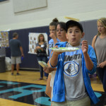 Middle School boy tries to catch a pancake at the lancer dancer pancake breakfast. Photo by Ellen Swanson
