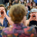 Seniors Jake Randa and Jack Griswold repeat a new chant as Senior Brayten Bowers teaches it to the school. Photo by Ellie Thoma