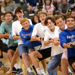 The Varsity Boys Soccer Team struggles to pull the rope over to their side to win tug of war against the football team. Photo by Ellie Thoma