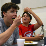 Junior Seamus Carroll takes a bite of his pancakes. Photo by Lizzie Kahle