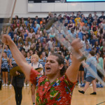 Even with his foot injury, Peter Haynes throws his crutches in the air to lead the new chants. Photo by Annie Lomshek