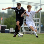 Junior Tommy Nelson pressures his defender. Photo by Audrey Kesler