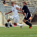 Senior Grant Roesner dribbles past a defender down the line. Photo by Audrey Kesler