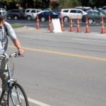 A biker smiles as he passes the bake sale. Photo by Caroline Mills