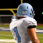 Junior Milton Braasch looks out at the scoreboard after the Lancers make another touchdown. Photo by Caroline Mills