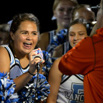 Senior Elyse Chinnok talks for a Hyvee ad, filmed by Fox News, with the rest of her varsity cheer squad. Photo by Kaitlyn Stratman