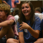 Freshman Caroline Chisholm laughs at her partners answer as they play a question game in circles at the STUCO retreat. Photo by Morgan Plunkett