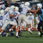 In the freshmen Rockhurst vs Shawnee Mission East game, two players go head on with eachother in the third quarter of the game. Photo by Morgan Plunkett