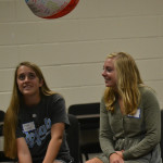 At the student council reatreat, seniors Hope Dunn and Allision Libeer watch as the ball lands on the floor, and high school students scramble for it. Photo by Morgan Plunkett