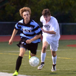 Junior Ian Schutt runs to get possesion of the soccer ball before the opposing team gets the ball. Photo by Katherine Odell