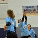 Sophomore Christina Brogden hits the ball with force in hopes of getting another point. Photo by Katherine Odell