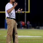 Coach Delaney reacts to a ref's call, and quickly after questions it. Photo by Kaitlyn Stratman