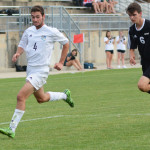 Senior Grayson Rapp chases down a ball in front of the goal. Photo by Carson Holtgraves