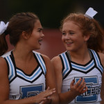 Sophomore Megan Packel and Junior Mya Hutcherson laugh after doing tumbling tricks. Photo by Carson Holtgraves