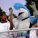Sophomore Deanthony Davis ooks at the Lancer to show that he has his hands up for the chant. Before, the Lancer had held them up for him. Photo by Kaitlyn Stratman