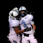 Senior Parker Shirling congratulates senior Trevor Thompson on his touchdown. This put the score at 16-14, with Rockhurst in the lead. Photo by Kaitlyn Stratman