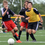 Freshman Daniel Adel tries to beat his opponent to keep possession of the ball.  Photo by Elizabeth Anderson