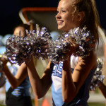 Sophomore Sarah Grimm cheers on the sidelines during 4th quarter. Photo by Ellen Swanson