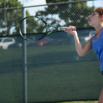 "Senior Joie Freirich takes calculatd moves to gain advantage in her singles game. Freirich said ""Singles are a better opportunity to challenge myself but doubles is more fun and less pressure"". Photo by Annie Lomshek"