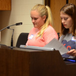 Senior class secretary and treasurer, Morgan Biles and senior student body president, Mazie Brooke, get set up for more student council kids to join them for the retreat. Photo by Grace Goldman