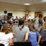 """The students of stuco play a PG version of """"Never Have I Ever"""" that requires them to sprint and find a new seat when the person in the middle says something that they have done before. Photo by Grace Goldman"""