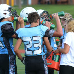 The East Freshman football team takes a quick water break after first quarter. Photo by Grace Goldman