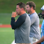Freshman coach, Coach Hair watches as his players tackle the Rockhurst freshman football team. Photo by Grace Goldman