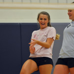 After spiking the ball, sophomore Lauren Fritz laughs with fellow teammate Andie McConnell. Photo by Libby Wilson