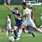 Moses Daung defends the ball from an opposing player. Photo by Libby Wilson