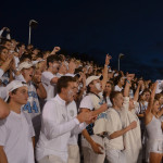 The junior student section cheers as the football team advances towards the endzone. Photo by Izzy Zanone