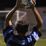 Junior Jac Pritchard throws the ball in to continue  the game. Photo by Izzy Zanone