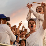 Seniors Ian Longan and Brayten Bowers lead the student section in a chant when the first run is made. Photo by Morgan Browning