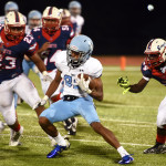 Junior Keyln Bolton runs past the other team with the ball. Photo by Morgan Browning