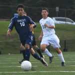 Freshman Daniel Adel attempts to steal the ball from west player. Photo by Ava Simonsen