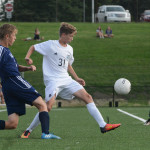 Freshman Simon Zimmerman defends East's goal from Shawnee Mission West players. Photo by Ava Simonsen