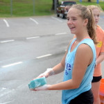 Junior Grace Apodaca soaks her sponge while waiting for more cars to arrive. Photo by Maddie Smiley