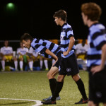 After East scores another goal against Olathe South, Junior Sam Ragland and senior Oliver Bihuniak wait at midfield for the kickoff. Photo by Sophie Storbeck
