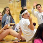 Seniors (from left to right) Maura Kate Mitchelson, Hope Dunn, Jacob De Sett, and Monty Lyndon waive and signal to their friend to come sit with them. Photo by Ellie Thoma