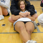 Senior Rachel Rodgers embraces Sophomore Megan Packel in her arms as they listen to the drum line. Photo by Ellie Thoma